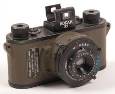 U.S. Army Signal Corps PH-324 Kodak 35 rangefinder camera without the leather case and neck strap. This one has the nomenclature plate on front of the camera showing the serial number 3615 and dating the camera to 1944.