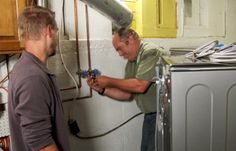 Richard Trethewey works on laundry pipes in a white-washed basement talking to a homehowner