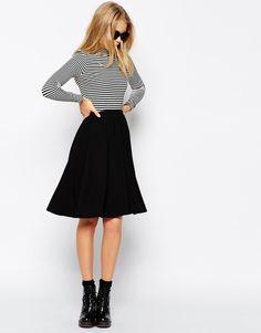 $36, Black Skater Skirt: Asos Collection Midi Skater Skirt. Sold by Asos. Click for more info: https://lookastic.com/women/shop_items/214919/redirect