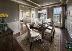 Traditional Dining Room with Pottery Barn Malika Persian-Style Rug 9'X12', Carpet, Custom Christian Parsons Chair
