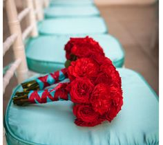Bridesmaid bouquets can be like this. All red carnations with white alstroemerias. Wrapped with white satin ribbon. 3 IN TOTAL.