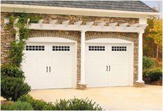 Pergola over garage doors softens view