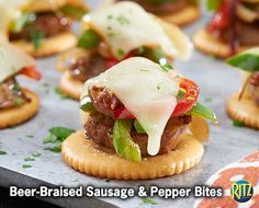 30 mins to make, serves 24 -- INGREDIENTS -- MEAT • 3 Italian sausage, links PRODUCE • 2/3 cup Sweet onions CONDIMENTS • 1 tbsp Dijon mustard, grainy BAKING & SPICES • 1/2 cup Green and red pepper strips SNACKS • 24 Ritz crackers DAIRY • 3 Muenster cheese slices, cut into 8 pieces OTHER • 1 cup Coors light®, divided