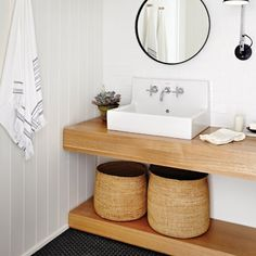 If you like this textural powder room, you'll love Suzanne Dimma's incredible Toronto based home tour!
