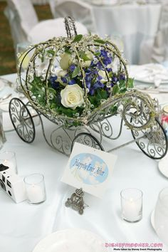 Beautiful Carriage Centerpieces from a Disney wedding. Absolutely gorgeous!