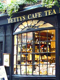 Looking through the window of Betty's Tea Room, York, North Yorkshire. Ah, for the good old days...