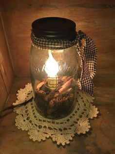 Quart Mason Jar Candle Lamp Bring a touch of primitive country charm to your decor by adding this Quart Mason Jar candle lamp to an end table or hutch. This pale green glass Quart Mason Jar Candle Lam