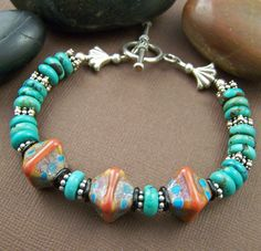 Artisan lampwork with turquoise and sterling silver. Gorgeous bracelet!