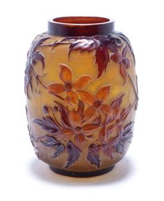 Emile Gallé - A Blow-Out Vase with Stems of Red Flora, circa 1900, in high relief against an amber ground, 24.5cm high, signed 'Galle' (faults)