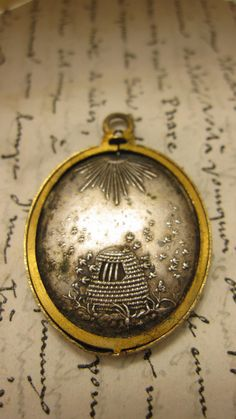 This is a very rare antique French photo locket pendant in rich warm old gold of a beehive and sun. Dates from the late 1800s.  #bees