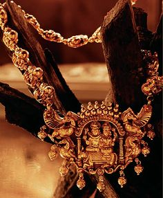 The extraordinary Tanishq Nakashi gold necklace, where Lord Shiva and Goddess Parvati are honored in an antique gold finish as an auspicious reminder of marital harmony. Diamond Jewelry, Gold Jewelry, Jewelry Necklaces, Women Jewelry, Fashion Jewelry, Gold Necklace, Indian Wedding Jewelry, Indian Jewelry, Bridal Jewelry