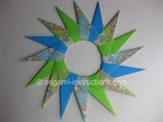 Origami paper star wreath. Different sizes layered could make a pretty holiday wreath.