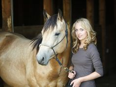 """Actress Amber Marshall, who plays the lead character, Amy Fleming, on the TV show """"Heartland."""" Amber is an AQHA member, and this is her own buckskin gelding, """"Cash."""" Photo by Shawn Turner."""