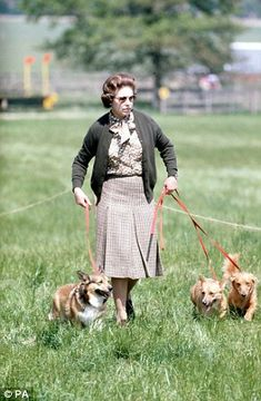The Queen and some of her corgis walk the Cross Country course during the second day of the Windsor Horse Trials in 1980.