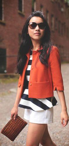 orange Blazer over Striped peplum top and white Shorts