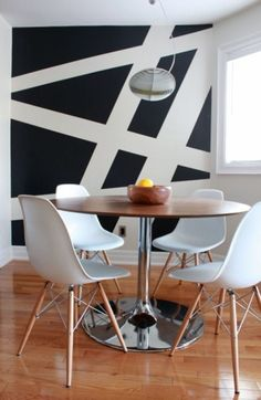 Geometric patterned painted walls. Accent wall. Geometric design. Geometric pattern. Random. Black and white. Home improvement ideas.