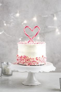 This candy cane peppermint cake is covered in a creamy white chocolate peppermint buttercream and is the perfect cake to make for Valentines day. Complete with an easy to make candy cane cake topper! Valentine Desserts, Valentines Day Cakes, Mocha Cheesecake, White Chocolate Buttercream, Strawberry Mousse, Peppermint Cookies, Chocolate Peppermint Cake, Noel Christmas, Chocolate Peanut Butter