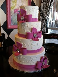 White piping and pink bows. by Designer Cakes By April, via Flickr
