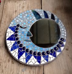 This one-of-a-kind stained glass mosaic piece measures 13 across with an off-set 7 mirror. The man in the moon design is made in various Mosaic Wall Art, Mirror Mosaic, Mosaic Glass, Glass Art, Sea Glass, Mosaic Crafts, Mosaic Projects, Mirror Man, Moon Mirror