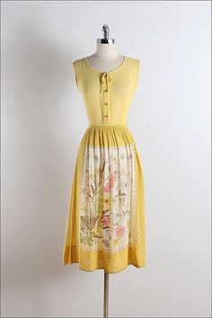 ➳ vintage 1950s dress  * yellow semi sheer cotton * beautiful floral skirt print * button front * metal side zipper * by Laiglon  condition | excellent  fits like xs/s  length 45 bodice 16 bust 36-38 waist 26  some clothes may be clipped on dress form to show best fit for appropriate size.  ➳ shop http://www.etsy.com/shop/millstreetvintage?ref=si_shop  ➳ shop policies http://www.etsy.com/shop/millstreetvintage/policy  twitter | MillStVintage facebook | millstreetvintage instagram…