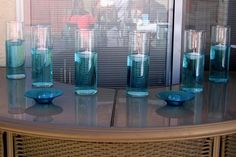 Colored water for floating candle centerpieces. Genius.
