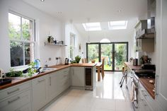 Kitchen idea - Longer kitchen design with small velux extension and bifold doors.