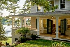 a wrap around porch on the water