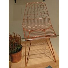 The chair that started it all for LA-based Bend debuted in a metallic copper and chrome finish. | Lonny