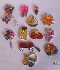 Several quilled Itsies