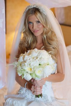 The Real Housewives of Miami's Joanna Krupa carried an all-white bouquet composed of garden roses, peonies, and stephanotis blossoms. Bridal Hair Down, Wedding Hair Down, Bridal Hair And Makeup, Wedding Makeup, Bright Bridesmaid Dresses, Brides And Bridesmaids, Wedding Bun, Wedding Gowns, Civil Wedding