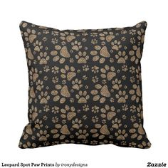Leopard Spot Paw Prints Throw Pillow Leopard Skin Design made with brown leopard spots inside the big cat paw prints on a black colored background. Elegant wild cat lover and pet lovers design with the leopard pattern print.