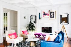 Looking to give your all-white living space a pop of color? Check out this colorful living room designed by Havenly. For more interior inspiration, head to Domino.