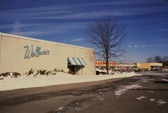 """Wallace's, Ulster Shopping Plaza, 1962 or later. Collection of John F. Matthews    This shopping center opened in 1962 on Albany Avenue Extension, just over the Kingston city line in the Town of Ulster and convenient to the IBM plant. The developer boasted in December 1961 that it would be """"the only truly modern shopping center in the trading area…."""" The three anchor stores were Woolworth's, Food Fair, and Wallace's."""