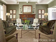 Sage Green Envelops The Room In A Cozy Hue While Shapely Sofas Face Off This E