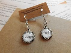 "Harry Potter ""Fred and George"" Weasley dangle earrings made from actual Book page ~ by LilShopofHodgePodge on Etsy, $8.25"