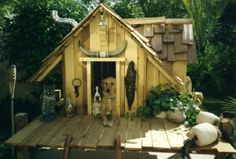 Wooden Doghouse with a Porch - all they need now is a Chandler 4 Corners rug!