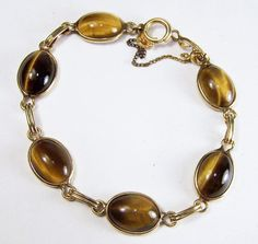 Vintage Ronci Tigers Eye Cabochon Bracelet by GretelsTreasures Tiger Eye Jewelry, Tiger Eye Bracelet, Antique Jewelry, Beaded Jewelry, Vintage Jewelry, Vintage Costume Jewelry, Vintage Costumes, Rings N Things, Vintage Vogue