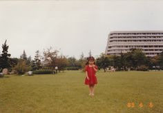 When I was young. Wearing red color one piece on a lawn during summer vacation.