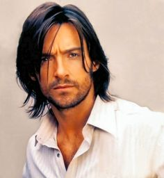 Hugh Jackman.  I don't know how old this picture is but it has to be from at least a few years ago.  This is a very 70's look.  He looks good in long hair, heck he looks good in short hair and no hair.