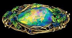 Art Nouveau enamelled opal brooch.