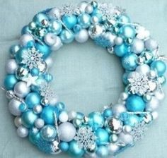 Christmas wreath with snowflakes. Light blue and winter white ornaments.