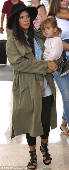 'I feel good, yeah!' The expecting 35-year-old went incognito in her hipster hat, baggy trenchcoat, chambray shirt, black leggings, and glad...
