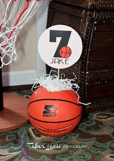 Cut holes in the tops of real basketballs, stuff with shredded paper/foam and stick in your paper centerpiece!