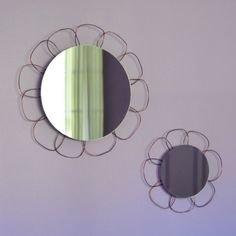 I've been thinking on some fun, sort of girly decor. I hit on a floral-themed idea to add a couple of inexpensive and lightweight mirrors