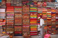 Traveled to India with my husband and his family several years ago. This is what a typical Sari shop looks like. It was an amazing experience that I will never forget. Indian Textiles, Indian Fabric, Sari Fabric, Sari Shop, Indian Colours, Amber Interiors, Relax, Travelogue, India Travel