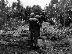 US Marines walking past dead Japanese as they moved on the peninsula on Peleliu, Palau Islands, Oct 1944