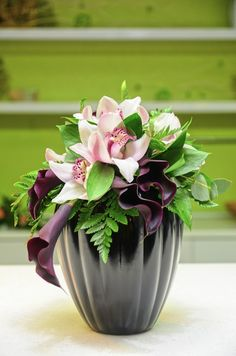 unusual vase with orchids for a wedding centerpiece | Modern wedding ideas