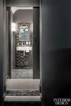 Heavenly Peace: Atelier Maia's Suburban Surprise | The mirror frame in a bathroom once belonged to a window in an Italian 19th-century church. #design #interiordesign #interiordesignmagazine #architecture #bathroom #stone
