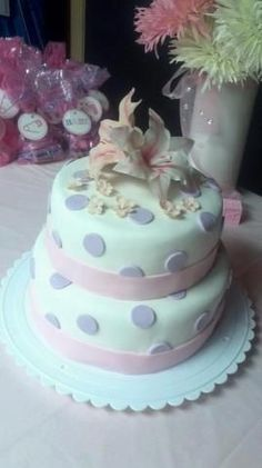 Pink and purple baby shower cake with gum paste lilies