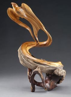 On Stonger Wings. Christopher White, wood sculptor.